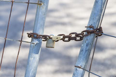 Closed. Fence work with chain and padlock closed royalty free stock image
