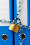 Closed file folder with chain Stock Photography