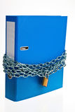 Closed file folder with chain. A file folder with chain and padlock closed. privacy and data security Royalty Free Stock Photo