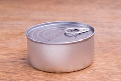 Closed Food Can on a Wooden Table Stock Photo