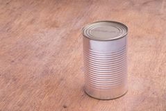 Closed Food Can on a Wooden Table stock photos