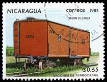 Closed freight car, Railroadcars serie, circa 1983. MOSCOW, RUSSIA - MARCH 23, 2019: Postage stamp printed in Nicaragua shows Closed freight car, Railroadcars stock images