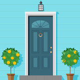 Closed front door with a lantern and ornamental plants in a pot. Vector illustration in flat style. Closed front door with a lantern and ornamental plants in a Royalty Free Stock Photo