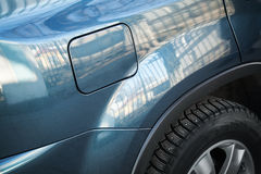 Closed fuel tank flap. Modern blue car closeup fragment Royalty Free Stock Photography