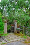 Closed garden gate. At rainy summer day Royalty Free Stock Photography