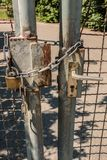 Closed gate with big steel chain and padlock.  Stock Images