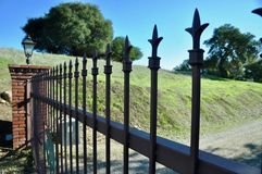 Closed gate on country property stock images