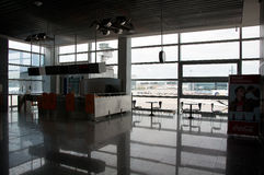 Closed gate and empty chairs on the airport Stock Photography