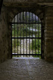 Closed gate at the end of a tunnel. In an ancient Byzantine castle, Greece Royalty Free Stock Photos