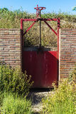 Closed gate in an irrigation canal Stock Images