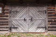 Closed gate in old wooden wall Royalty Free Stock Images