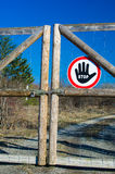 Closed gate with stop sign outdoor Stock Photography