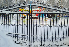 Closed gates of amusement park in winter Royalty Free Stock Image
