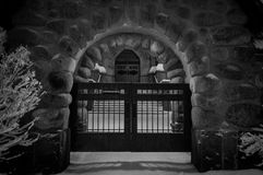 Closed gates in stone arch Stock Image