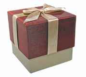 Closed gift box with a gold ribbon Stock Image