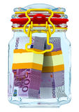 Closed glass jar with bundles of euro Stock Photo