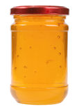 The only closed glass jar with honey Stock Images