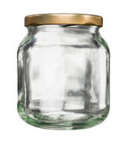 Closed glass jar with lid. Closed empty glass jar with metal lid isolated on white stock photography