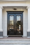 Closed Glossy Black and Glass Front Doors of an Upscale Home Stock Photos