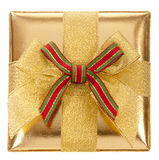 Closed gold gift box Stock Images