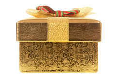 Closed gold gift box Stock Image