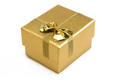 Closed golden gift box Stock Photography