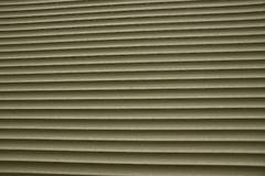 Closed gray blinds on the window of a private building stock photography