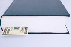 Closed green book with a bookmark 100 USD. Closed green book with a bookmark 100 dollars. front view Stock Photo