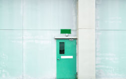 Closed green door with green text box on green concrete wall. With copy space Stock Photo