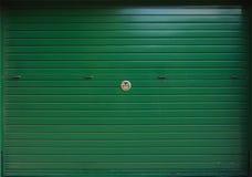 Closed green metal garage gate, texture Stock Photos