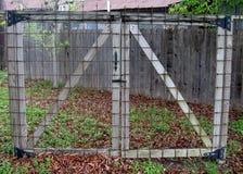 Closed grid gate. Backyards closed metal grid gate Stock Photo
