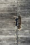Closed with a handle door of boards Royalty Free Stock Photography