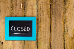 Closed - handwritten in chalk on framed blackboard sign hanging Stock Images