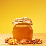 Closed honey jar and potpourri Stock Image