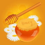 Closed honey pot and stirring stick with white camomiles on yell. Ow background Stock Images