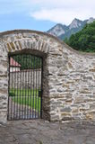 Closed iron gate and stone wall Stock Photos