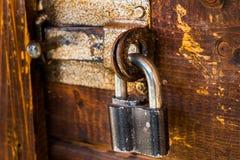 Closed iron lock on the door stock image