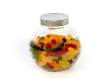 Closed jar filled with wine gums. Closed candy jar filled with wine gums on white background Royalty Free Stock Photos