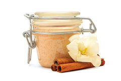 Closed jar with some creamy substance and cinnamon Stock Photography