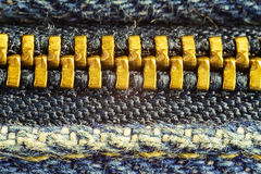 Closed jeans zipper, high magnification macro image. Royalty Free Stock Photos