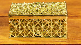 Closed jewelry box for decorations with a heart pattern on a wooden table stock footage