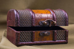 Closed Jewlery Chest. Old carved treasury chest on brown background royalty free stock image