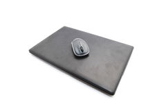 Closed laptop computer with mouse Royalty Free Stock Image