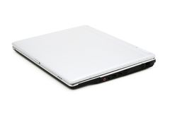 Closed Laptop (isolated). Closed silver laptop on a white background with pretty shadow Royalty Free Stock Image
