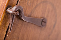 Closed Latch. Closeup of a old latch that closes a wooden box Royalty Free Stock Images