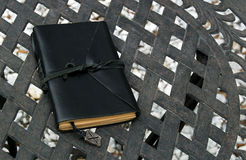 Closed leather bound journal on table outdoors Royalty Free Stock Photo
