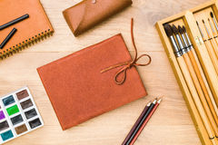 Closed leather notepad and watercolor Stock Photography
