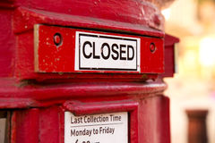Closed letterbox. A closed red english letterbox Royalty Free Stock Images