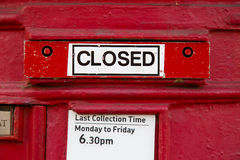 Closed letterbox. A traditional closed red letterbox Royalty Free Stock Photos