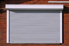 Free Closed Light Grey Security Shutters Royalty Free Stock Images - 118705259